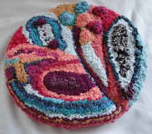 Hooked and progged seat mat by Julie Laker